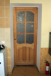 wooden kitchen door with fire extinguisher