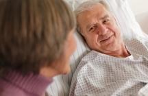 Senior Patient in Hospital Bed